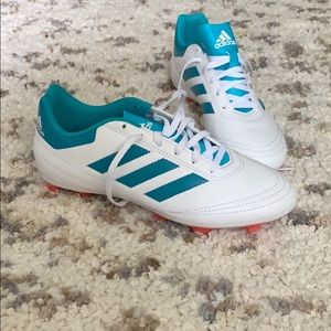 White and teal adidas soccer cleats